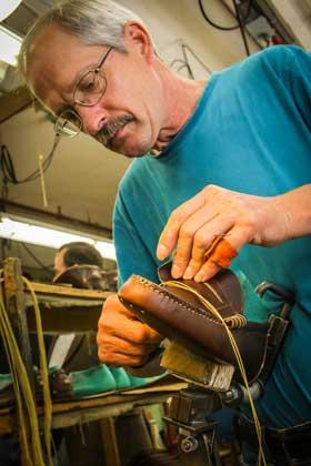 Rancourt & Co. employee hand sewing.