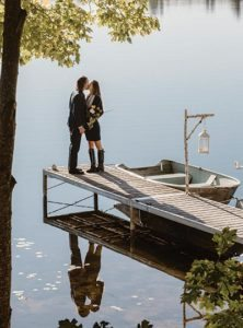 Couple on dock at Wolf Cove Inn - LA Metro Magazine